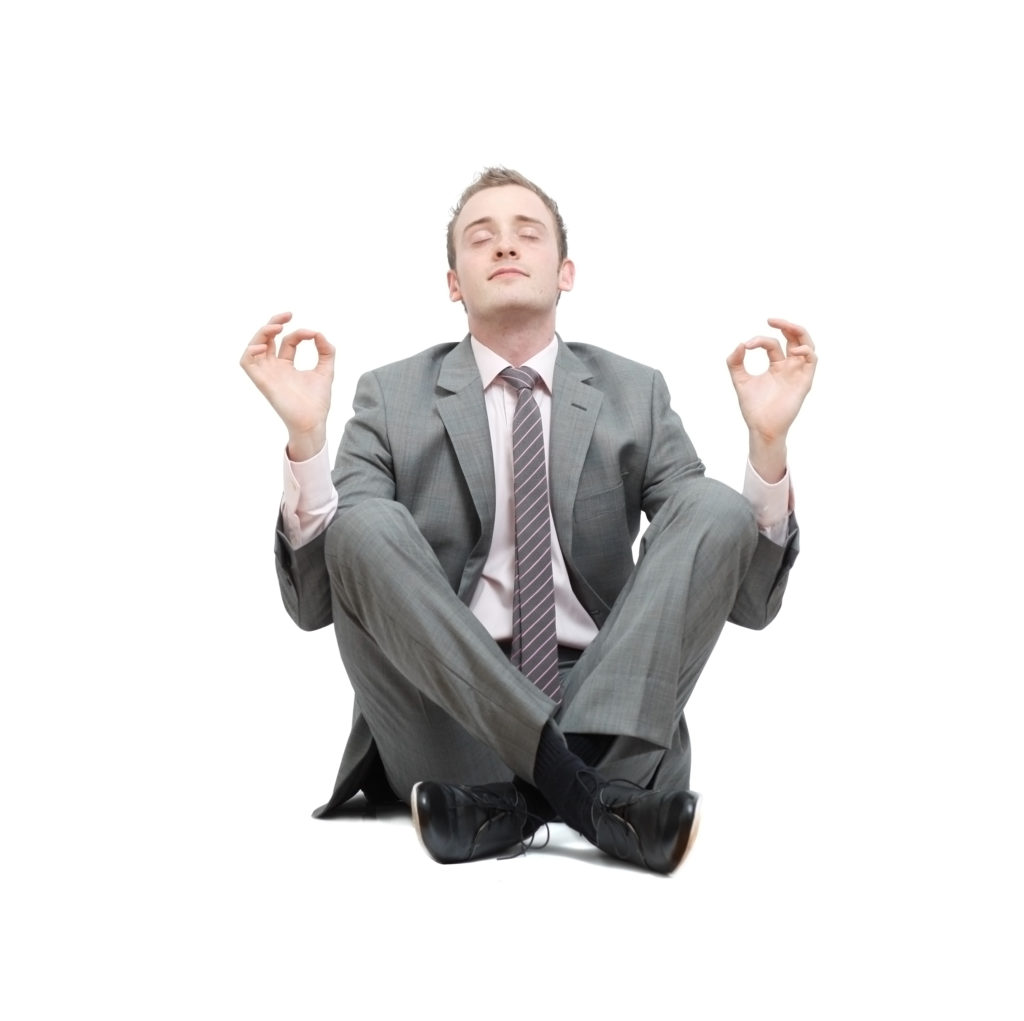 Businessman in suit meditating