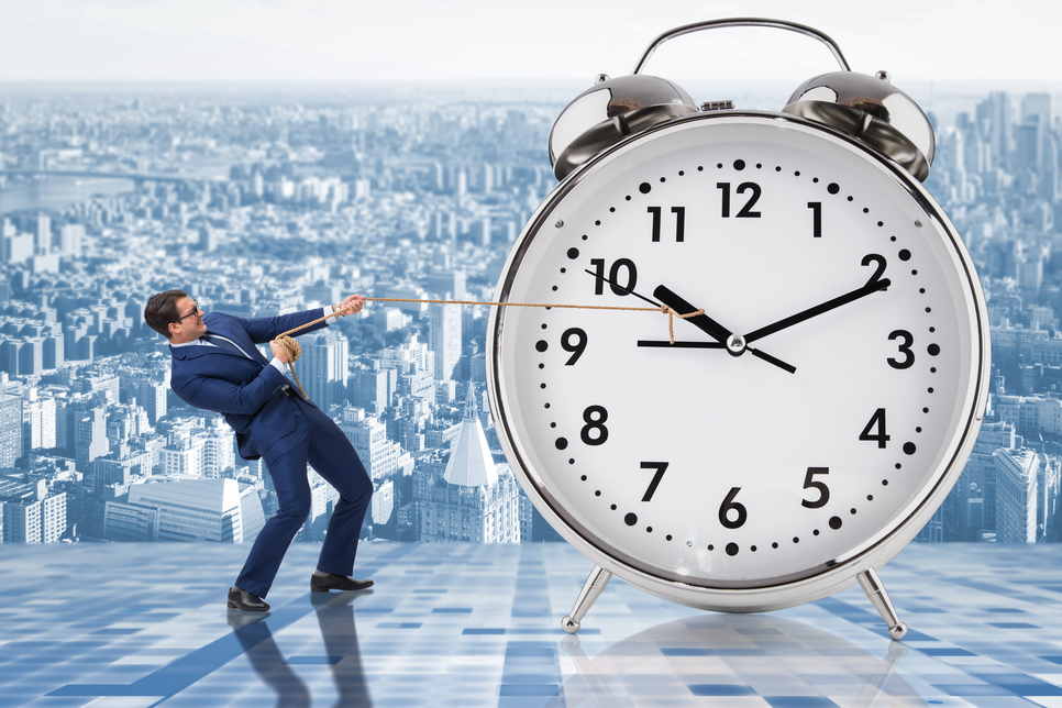 Businessman pulling clock because times up