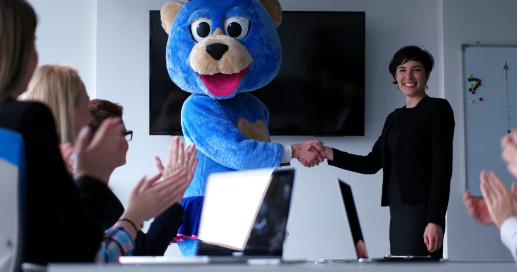 Man in bear costume leading sales meeting