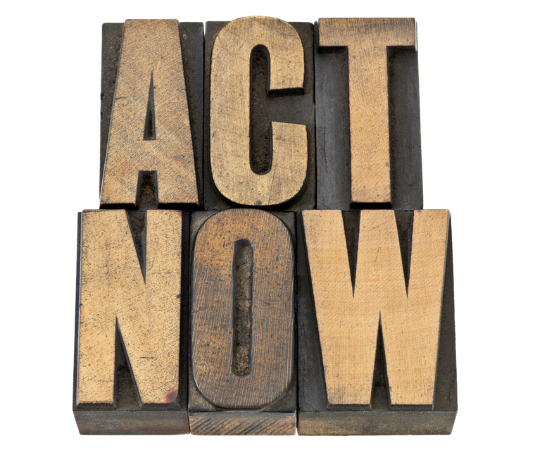 "The words ""act now"" in bold, carved into wood"
