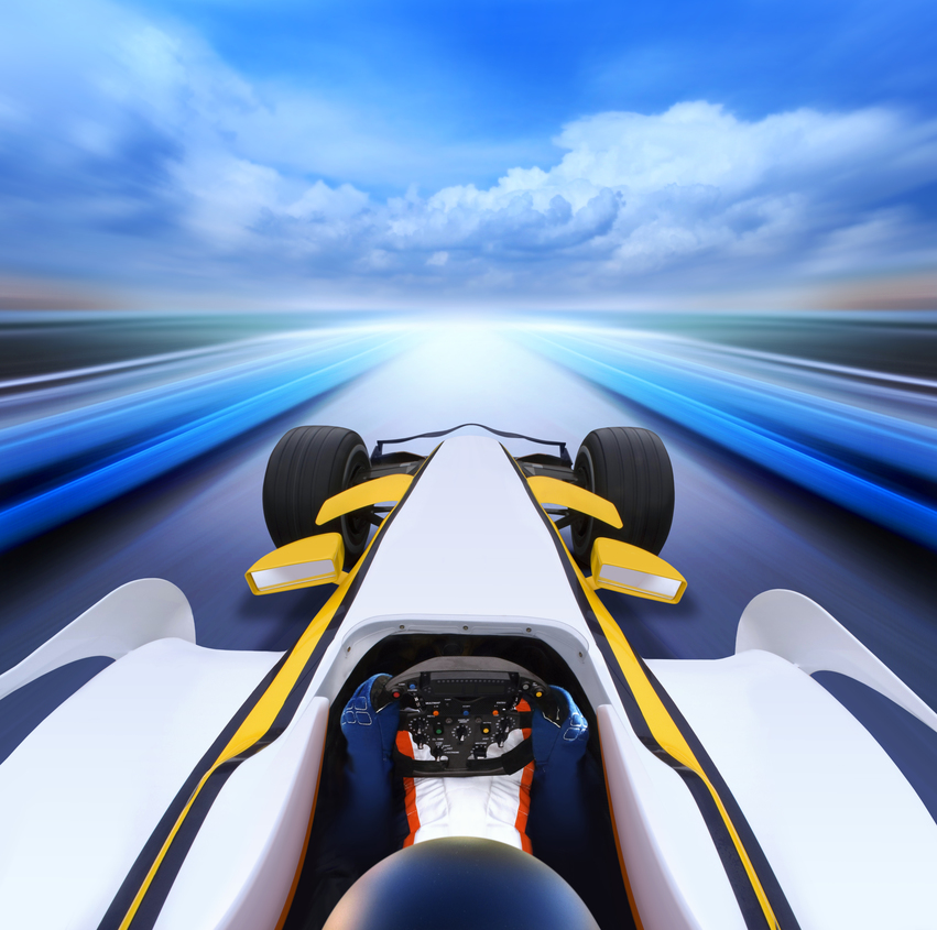 Indy Car driving at high speed, with motion blur in the image