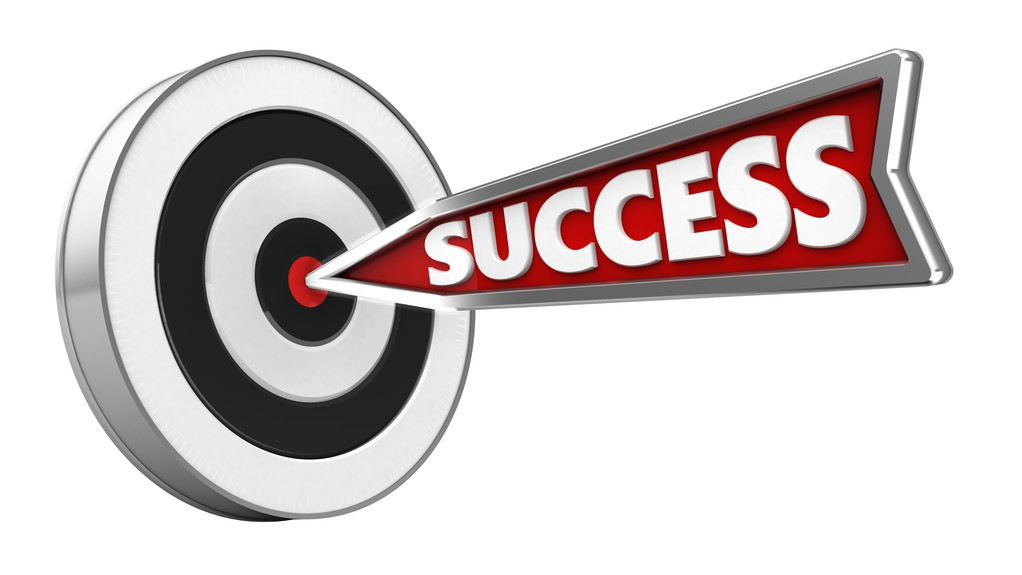 "Arrow with word ""success"" written on it hitting bullseye"